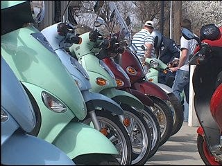 Commuters use scooters to skimp on gas