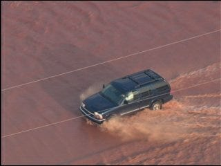 Flooding, downed power lines close roads