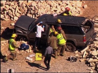 Children pulled from car wreck