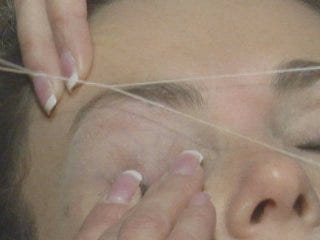 Woman uses thread instead of waxing, plucking