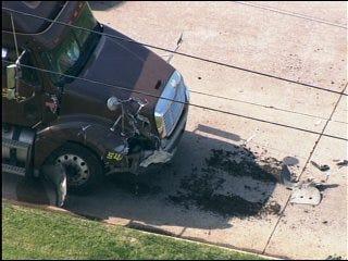 City bus, tractor-trailer collide
