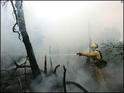 Wildfire Still Burns, More Mud Slides