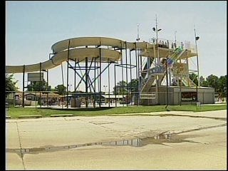 Girl pulled from water park pool dies