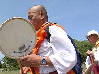 Native group walks to save 'Mother Earth'