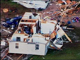 Storms spawn tornadoes, flooding