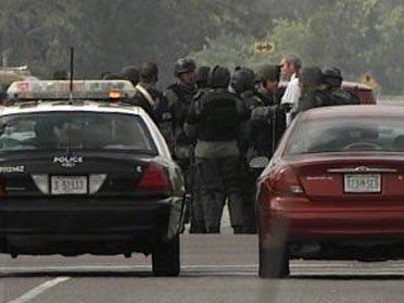 Suspect surrenders in standoff