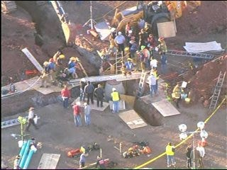 Man Trapped in Collapsed Trench