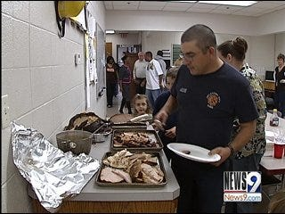 Firefighters Celebrate At the Station With Family