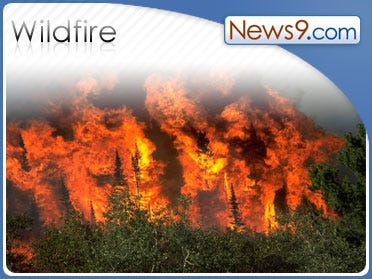 Wind-whipped L.A. wildfire burns mobile homes