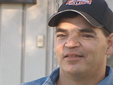 Man struggles after saving neighbor from fire