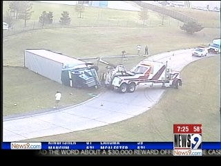 Overturned tractor-trailer rig slows morning traffic