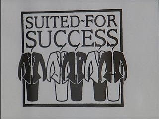 Suited for Success Holding Monthly Sell