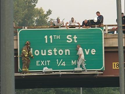 Crews Rescue Man Stranded on Highway Sign