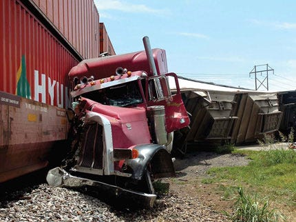 Train and Transport Truck Collide in Enid