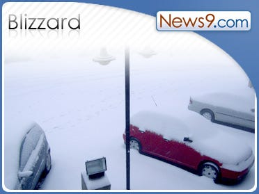 Blowing snow closes roads, strands motorists