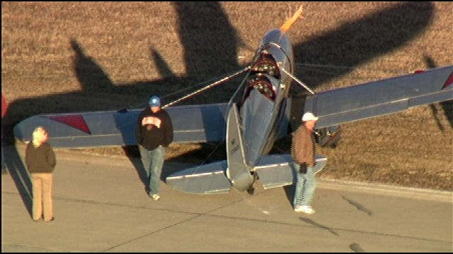 1940s Plane Slides Off Runway At OKC's Wiley Post Airport
