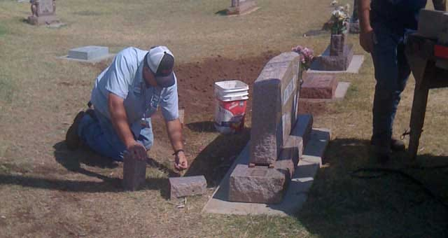 Moore City Workers Repair Tombstones After Cemetery Shootout
