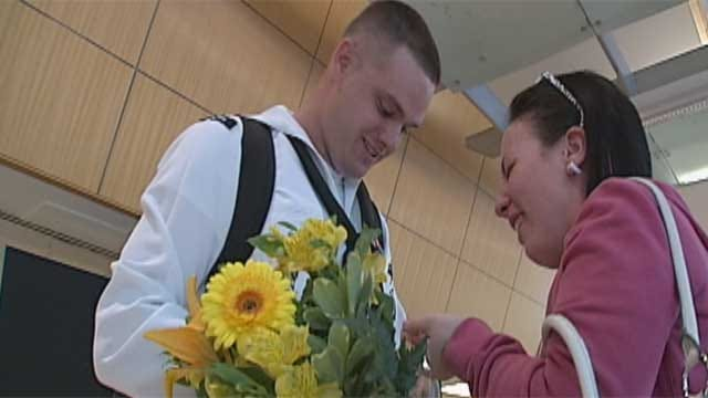 OK Sailor Returns Home, Proposes To Woman He Loves