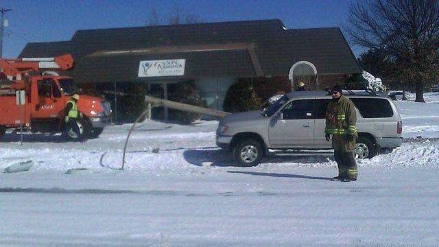 Car Slides Into Power Pole, Emergency Crews Say Roads Still Very Slick