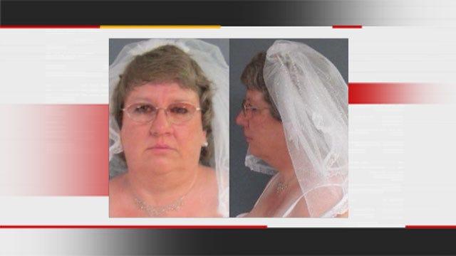 Bride Takes Mug Shot In Wedding Gown