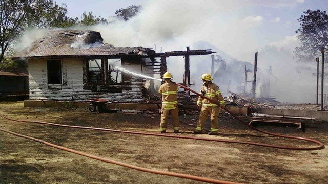Firefighters Attack House Fire In Rural Logan County