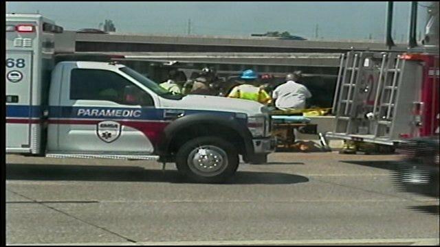 Asphalt Truck Overturns, Traps Worker On I-35