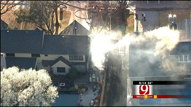 Fire Spreads Along Fence to Homes In Northwest OKC