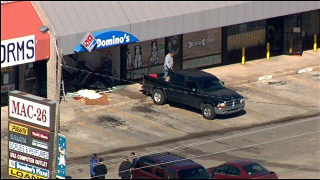 Suspected Drunken Driver Crashes Into OKC Dominos Pizza Store