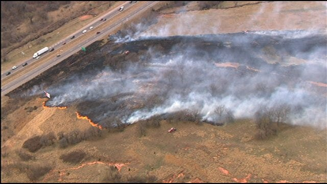 Firefighters Battle Wildfire Near I-40 And Choctaw Road