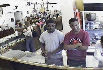 Police Search For Pawn Shop Robbers