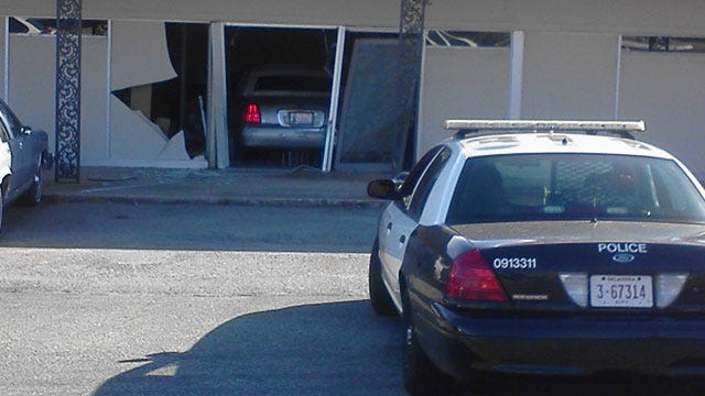 Car Crashes Into Northwest OKC Building After Woman Claims Brakes Failed