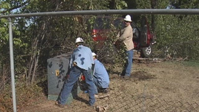 SUV Crashes Through Fence, Clips Electrical Box In Norman