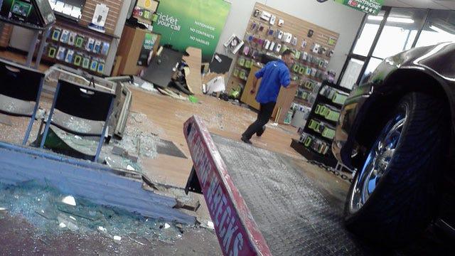 Vehicle Crashes Through South OKC Phone Store