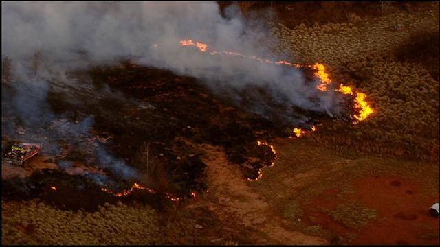 Crews Douse Grass Fire Near Lake Stanley Draper