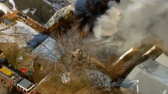 Fire Crews Battle Blaze At Midwest City Home