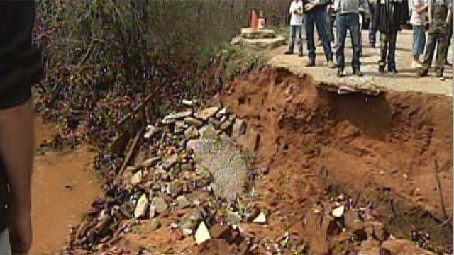 Volunteers Meet To Repair Rain-Damaged Bridge