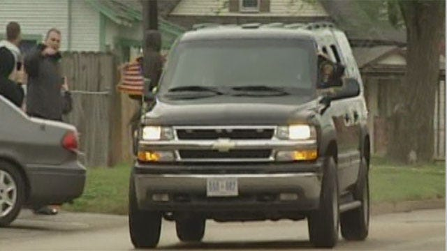 Supporters, Opponents On Hand For Presidential Motorcade