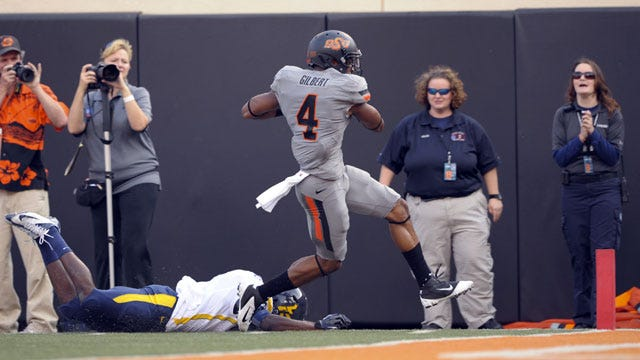 Oklahoma State Pulls Away From West Virginia 55-34