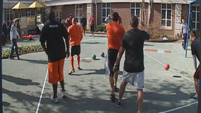 Former OU, OSU Football Players Kick Off Holiday Helpers Gift Drive