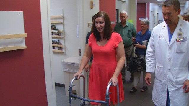 Injured Plaza Towers Teacher Takes First Steps