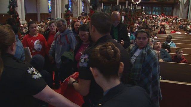 Law Enforcement Officers Bring Christmas Cheer To Metro Kids