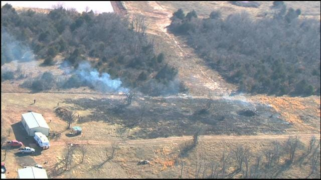 Firefighters Put Out Grassfire In Luther