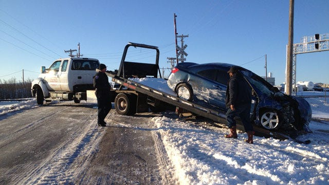 Train Hits Car Stuck On Snow-Covered Tracks In Woodward