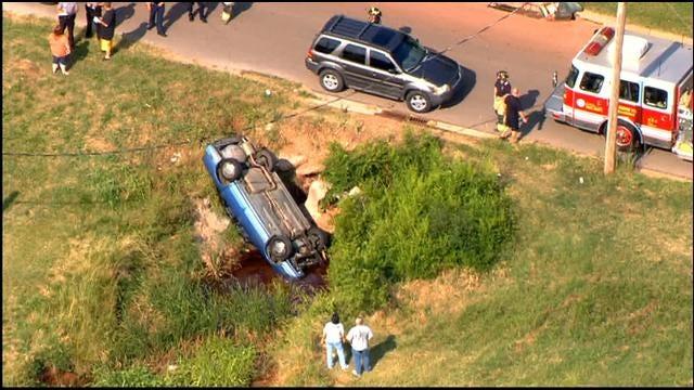 Car Flips, Crashes Into Creek In SE OKC