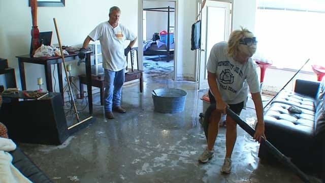 Downtown Businesses, Residents Assess Flood Damage