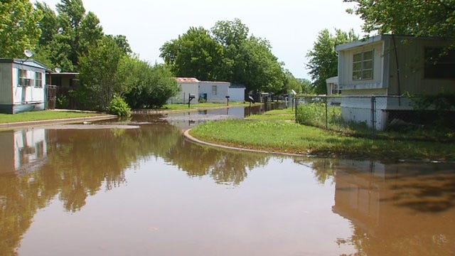Floodwaters Still Keeping MWC Residents From Going Home