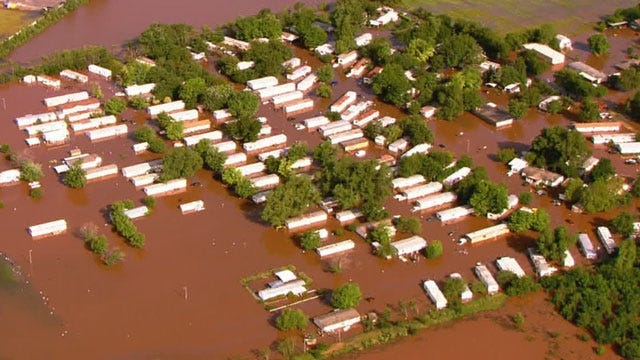 Some Crutcho Residents Refuse To Leave Flooded Mobile Home Park