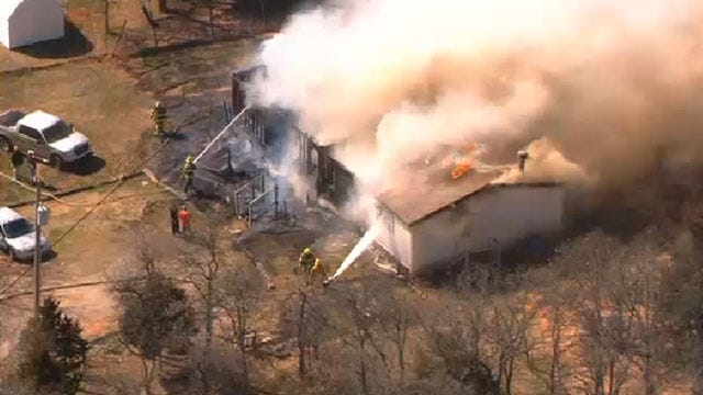 Firefighters Extinguish House Fire In Harrah