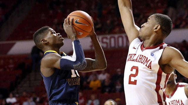 Sooners Hold Off West Virginia To Win Home Finale