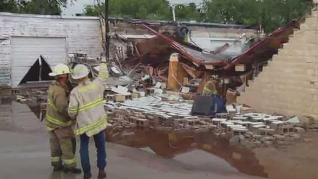 Roof Collapses On Building During Storm In Mustang